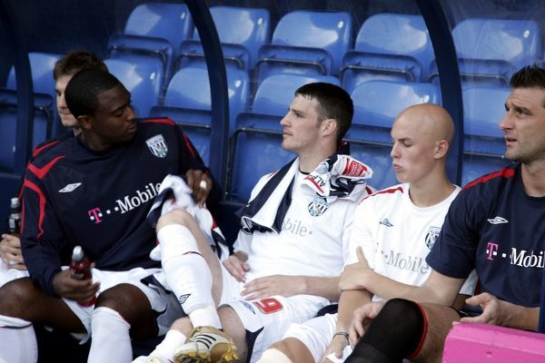 Albion's substitutes wait on the bench