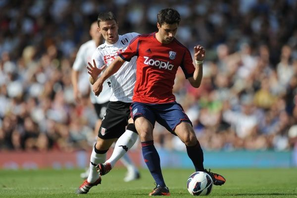 Fulham's Chris Baird (left) and West Bromwich Albion's Claudio Yacob battle for the ball