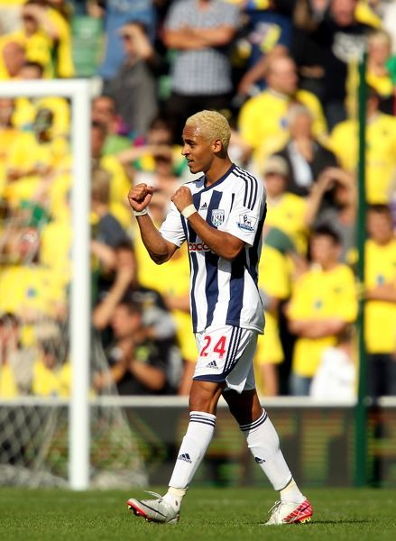 West Bromwich Albion goalscorer Peter Odemwingie celebrates his sides victory at the end of the match
