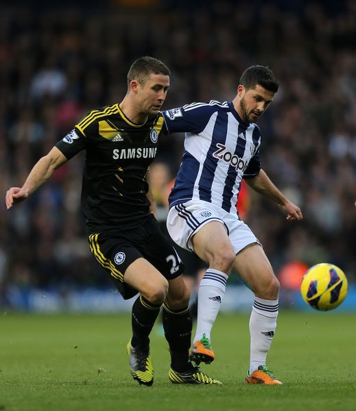 Chelsea's Gary Cahill (left) and West Bromwich Albion's Shane Long battle for the ball