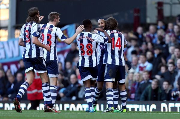 West Bromwich Albion's Nicolas Anelka is mobbed after scoring his sides second goal during the Barclays Premier League match at Upton Park, London