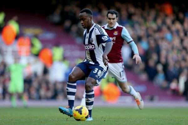West Bromwich Albion's Saido Berahino performs a back heel under pressure from West Ham United's Joey O'Brien during the Barclays Premier League match at Upton Park, London
