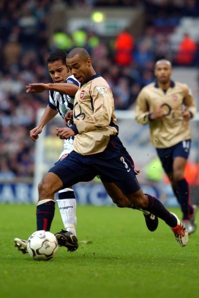 West Bromwich Albion's Adam Chambers battles with Arsenal's Ashley Cole