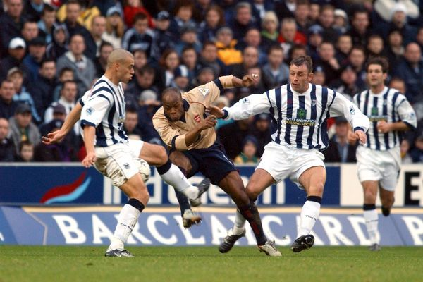 West Bromwich Albion's Derek McInnes (r) and Neil Clement (l) and Arsenal's Sylvain Wiltord (c) in action