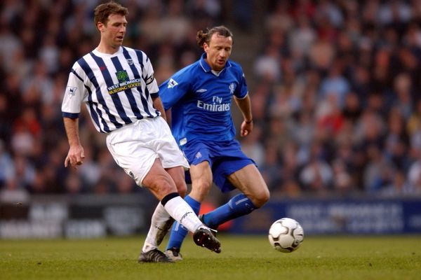 West Bromwich Albion's (l) Sean Gregan passes the ball under pressure from Chelsea Mario Stanic (r)