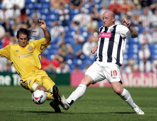 John Hartson fights for a loose ball