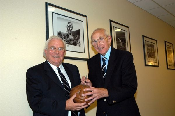 Ray Barlow signs the 1954 FA Cup Final ball, accompanied by director Joe Brandrick