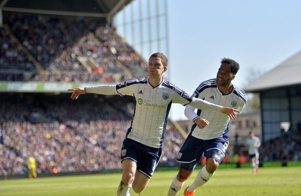 Craig Gardner of West Bromwich Albion celebrates after scoring a goal to make it 0-2 Joleon Lescott of West Bromwich Albion