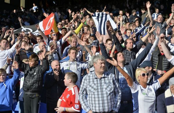 the travelling West Bromwich Albion Fans enjoy the match in the sunshine