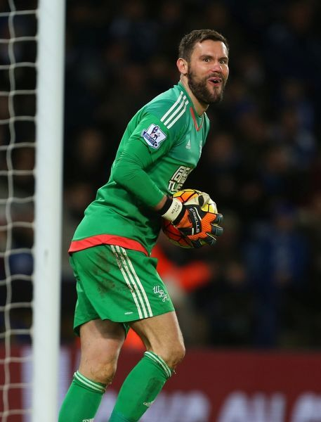 Ben Foster of West Bromwich Albion pulls a face after he makes a save