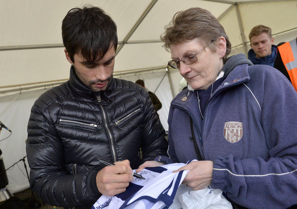 Claudio Yacob of West Bromwich Albion meets some of the West Bromwich Albion Fans at the FanZone ahead of todays match where he signed autographs and posed for pictures