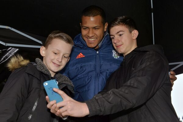 Salomon Rondon of West Bromwich Albion meets West Bromwich Albion Fans and signs autographs & poses for pictures in the FanZone