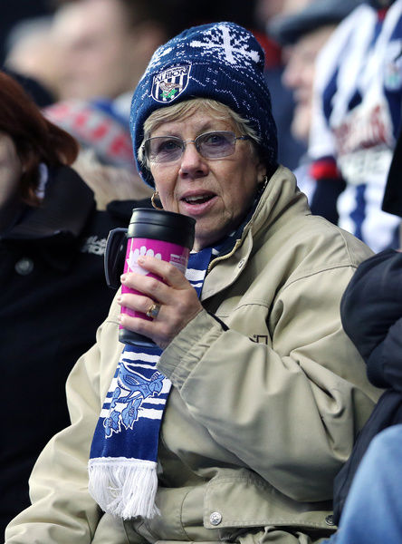 West Bromwich Albion fans drinks from a mug during the match