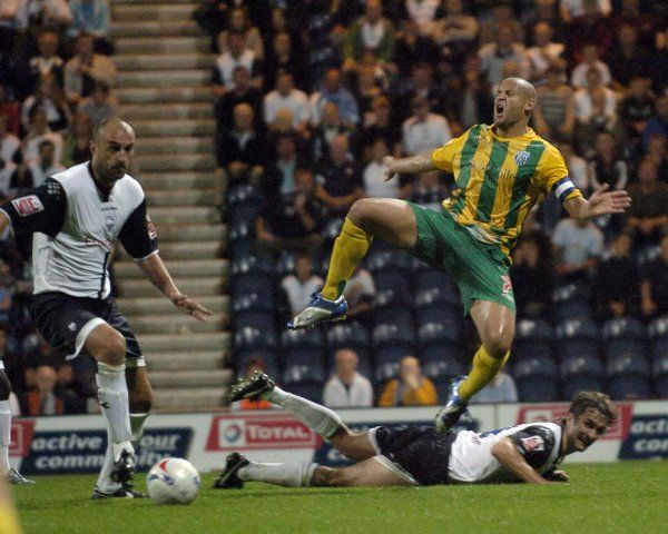 TE120906PRES11..PIC TIM EASTHOPE. Pictured in the Coca-Cola Championship match at Deepdale between Preston North End and West Bromwhich Albion is Nigel Quashie jumps over Danny Pugh