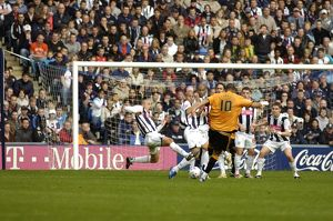 Albion charge down a Wolves free-kick