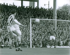 Astle heads the ball into the box