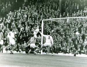 Astle (out of picture) heads in goal number two as Clive Clark follows it in