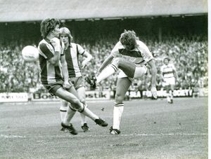 Bryan Robson gets in a block