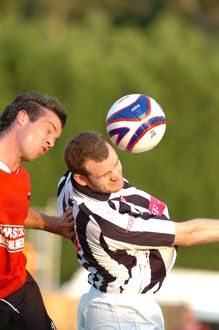 Craig Beattie challenges for the ball