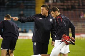Craig Shakespeare gives instructions to Jason Koumas