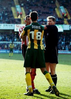 Curle squares up to Scott Dobie