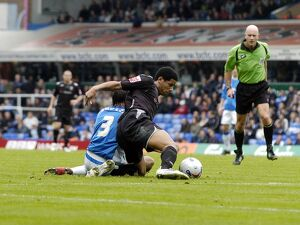Curtis Davies wins possession in the Blues' area