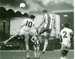 Cyrille Regis wins a header against Coventry