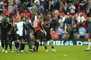 Disconsolate Albion players watch Derby's celebrations