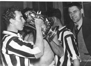 Frank Griffin enjoys a drink from the cup his goal won