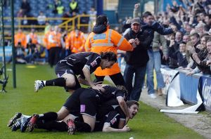 Gera is mobbed after scoring the winner