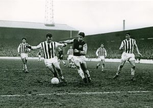 Graham Williams brings the ball away from Geoff Hurst