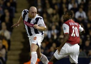 Hartson powers in a header against his former club