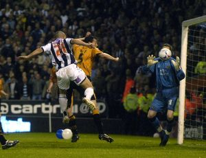 Kevin Phillips heads in