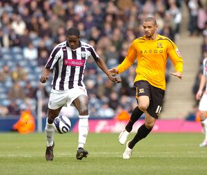 Leon Barnett brings the ball out from the back