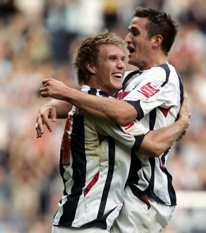 Martin Albrechtsen and Darren Carter celebrate after the Dane gives Albion the lead