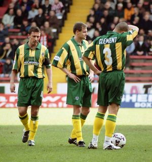 McInnes, Clement and Balis prepare for a free-kick