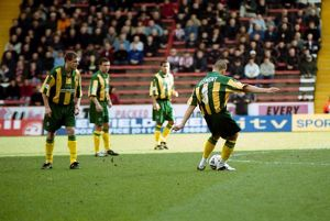 Neil Clement takes a free-kick