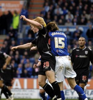 Paul McShane goes up for a header