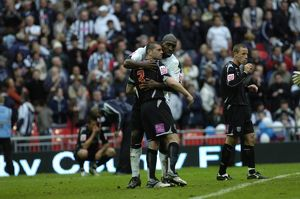 Paul Robinson and Darren Moore share a tender moment
