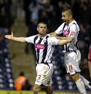 Paul Robinson an Kevin Phillips celebrate number 5