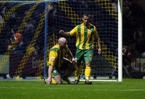 Phillips commiserates with Hartson after his header hits the bar