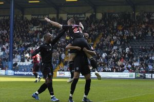 Phillips is held aloft after making it 1-0