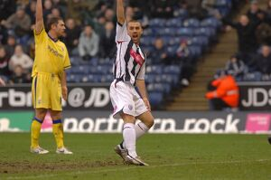 Phillips salutes McShane's cross after Albion score