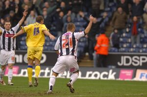 Phillips turns to celebrate as Albion draw level