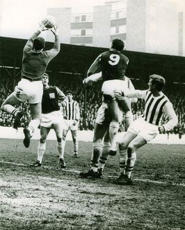 Ray Potter collects a cross under pressure from Hurst