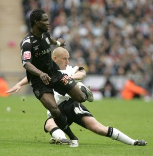 Sam Sodje is first to the ball