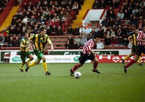 Scott Dobie attacks the United goal