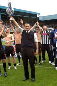 Tony Mowbray lifts the trophy