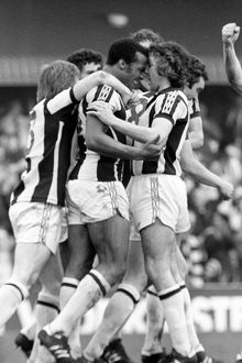 West Bromwich Albion's Cyrille Regis (centre) is congratulated by team-mates