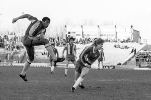 West Bromwich Albion's Cyrille Regis (l) shoots past Chelsea defender Graham Wilkins